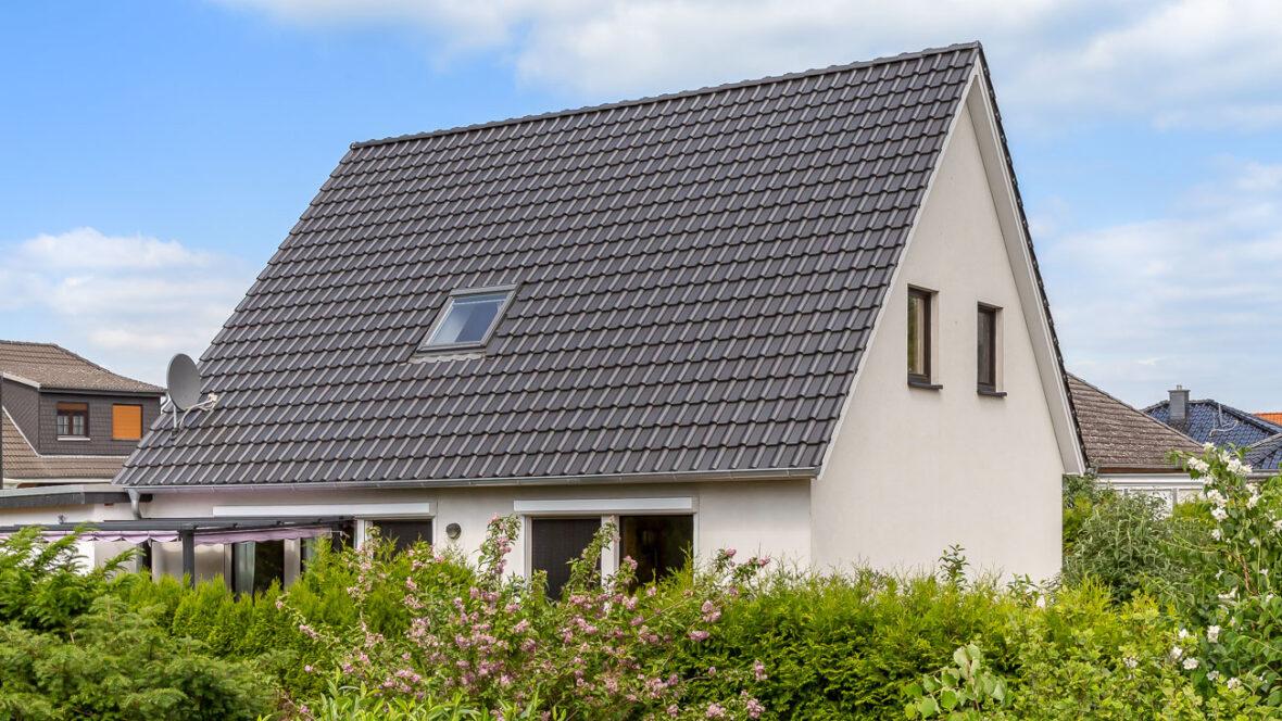 Flat roof tile old black
