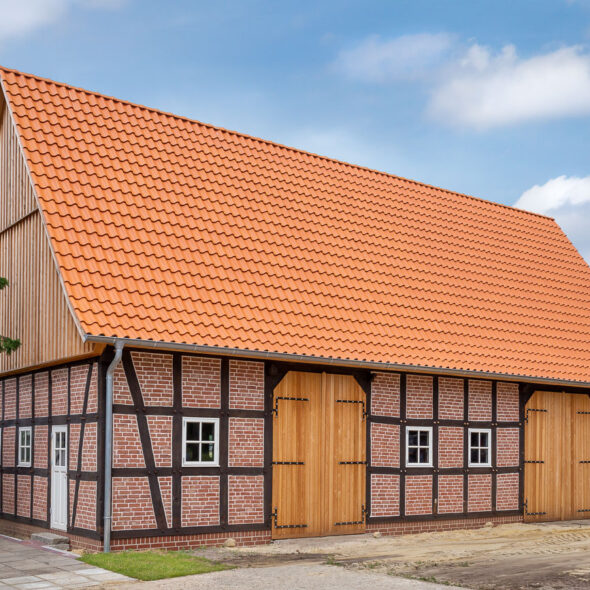 Barn with interlocking tile in natural red light