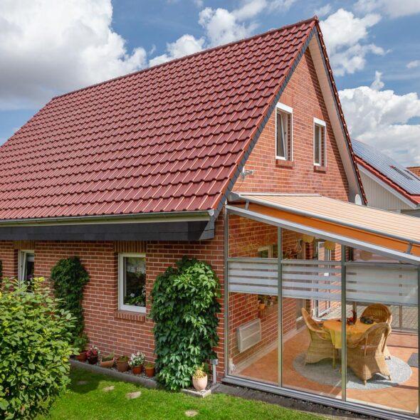 Einfamilienhaus mit Klinkern und J11v in toskanarot matt